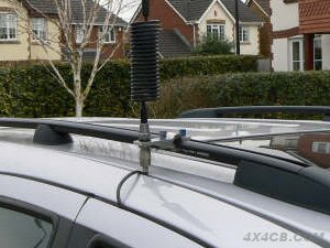 A two bolt bar mount mounted on the roofbars of an estate car