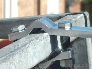A close-up of a 2-Bolt bar mount on a roofrack - you can just make out where the galvanised layer has been scraped off to get an earth connection