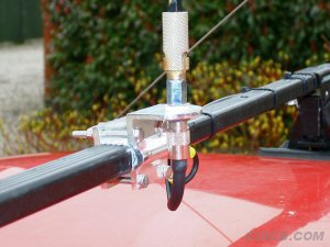 A Two-Way Roofrack mount fitted to a single Thule type roof bar which is plastic coated and wouldn't a large enough area of metal to act as a ground for the aerial anyway - again an earth strap has been used