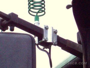 A Two-Way Roofrack mount on the mirror arm of a tractor