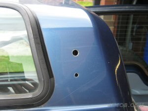 The holes needed for the PSM-1 mount, shown here on the side of a Land Rover Discovery